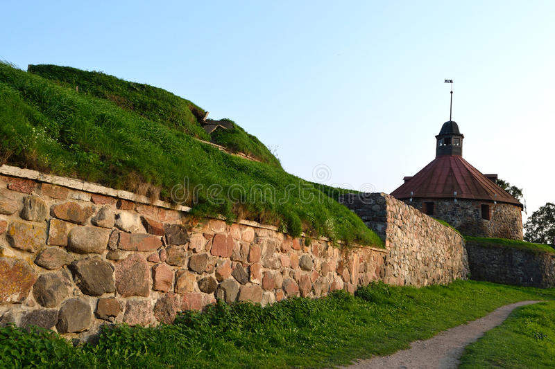 Wall of old Korela fortress at evening stock photography