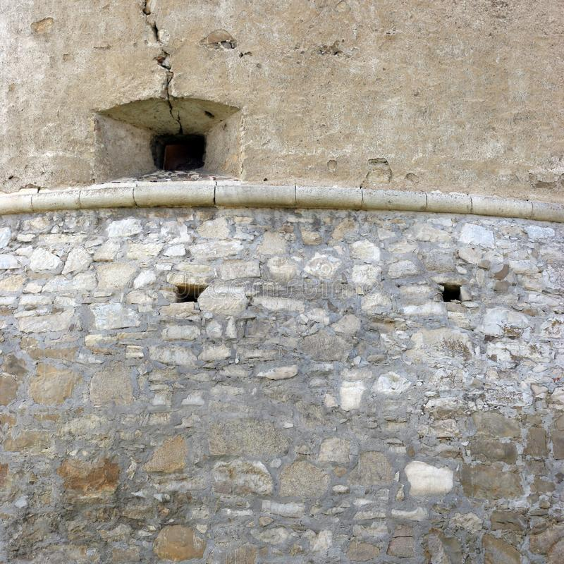 Wall of an old medieval building - guard post royalty free stock image