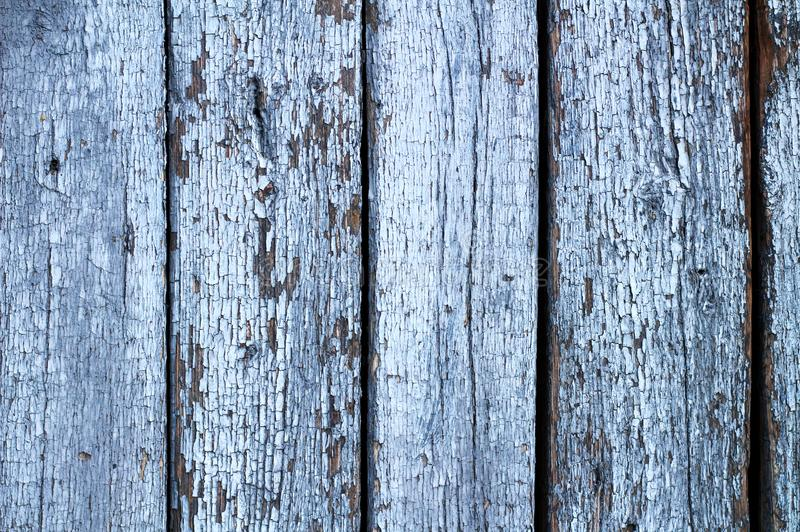 wall of old painted cracked wooden boards. Vintage background for photos stock photo