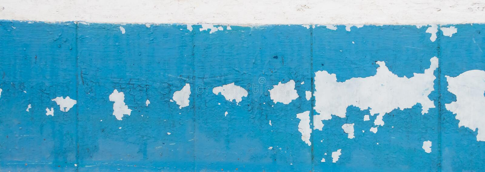 Wall with old peeling blue paint. Texture of old peeling paint, vintage graffiti background, it`s time to make repairs, cracked paint texture.  Clipart royalty free stock images