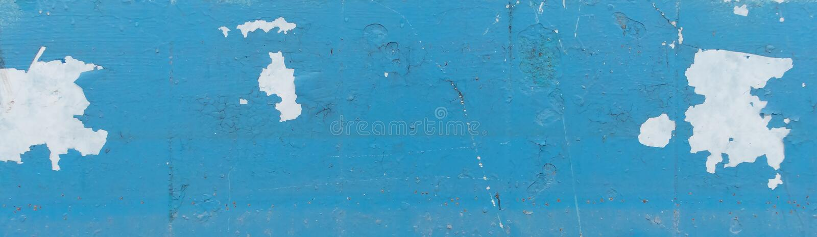 Wall with old peeling blue paint. Texture of old peeling paint, vintage graffiti background, it`s time to make repairs, cracked paint texture.  Clipart royalty free stock photos