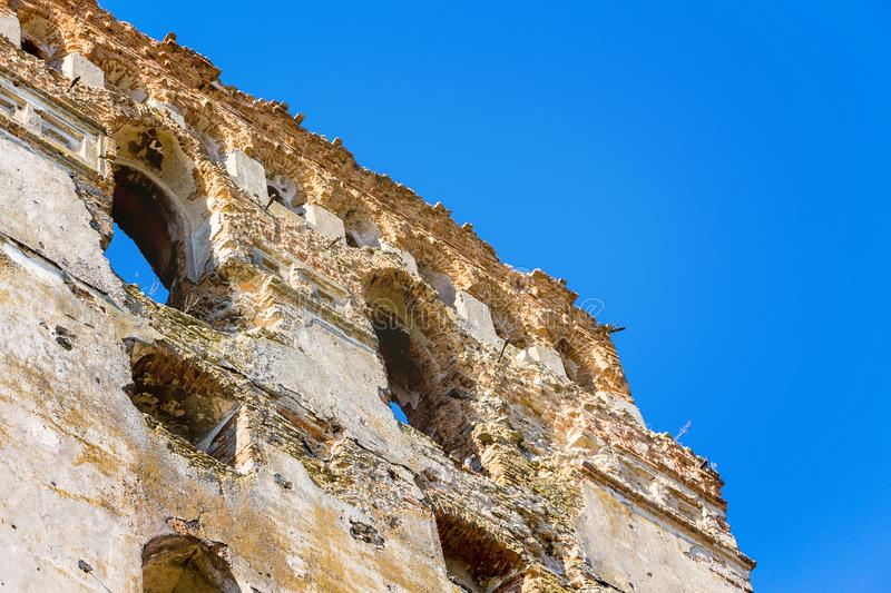 The wall of the old ruined castle. The ruins of a medieval fortress_ stock photos