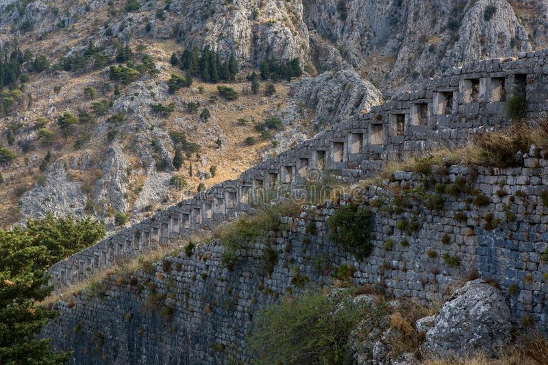 Wall of an old stone fortress royalty free stock photography
