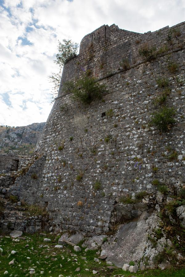 Wall of an old stone fortress stock photography