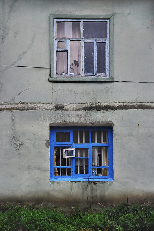 The Wall Of An Old Stucco House With Two Windows: A Slim Window Gray ...