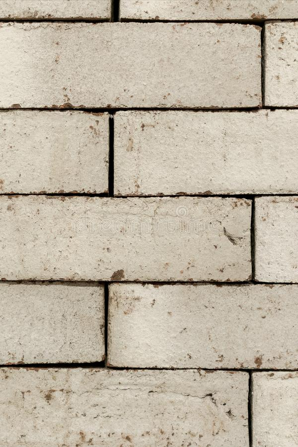 Wall of an old uneven brown brick. background royalty free stock photography