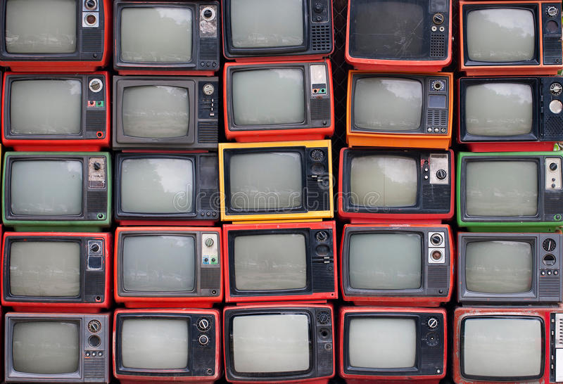 Wall of old vintage televisions stock photography