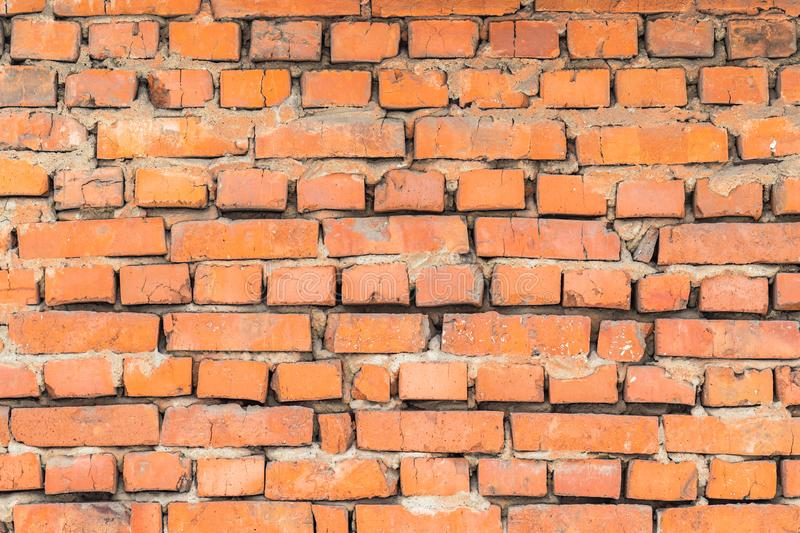 A wall of old worn red brick. as a background royalty free stock photography