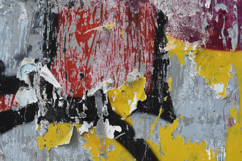 Wall paint and texture closeup. A closeup of a spraypaint and torn poster background royalty free stock image