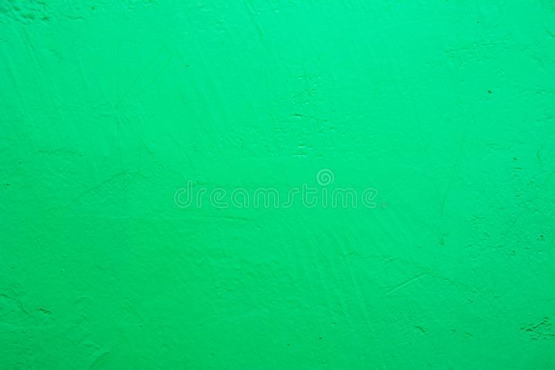 Wall painted in blue texture. Seamless texture of a light pale green concrete wall. stock photography