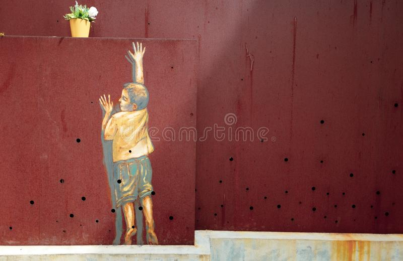 The wall painting of a boy stock image