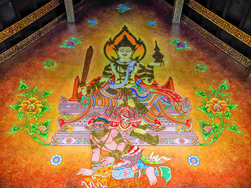 Wall Painting of God Sitting over Thai Giant stock photo