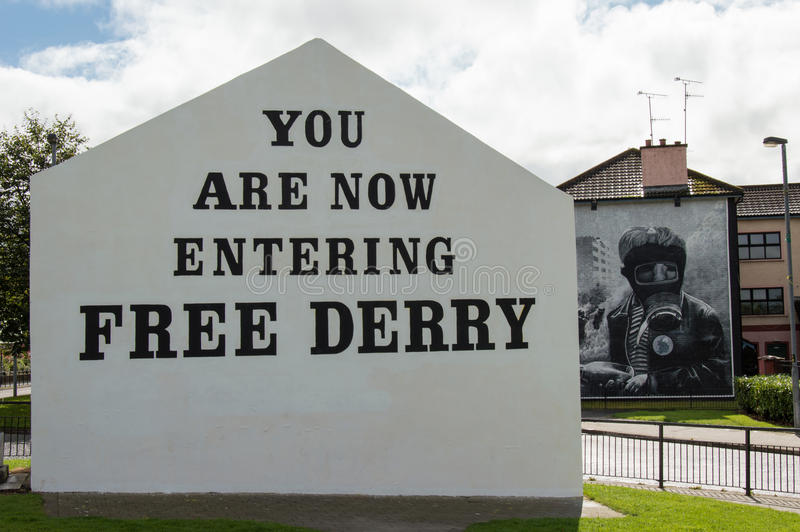 Wall Painting Roads in Derry (LondonDerry). Bloody Sunday memorial wall-paintings road in Londonderry (Derry), Ulster, Northern Ireland. You are now entering stock photos