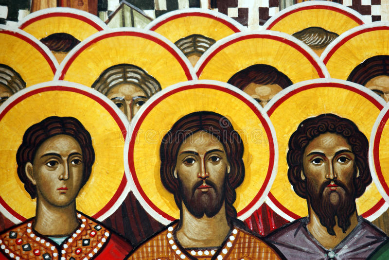 Wall painting of Saints. Colorful wall painting of a group of saints with red and yellow halos royalty free stock photos