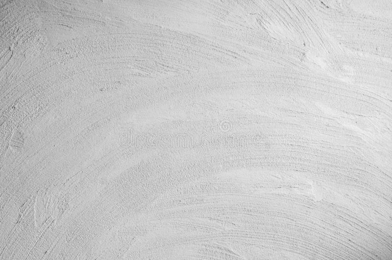 Wall panel grunge white,light grey concrete with light background. Dirty,dust white wall concrete backdrop texture and splash or a royalty free stock image