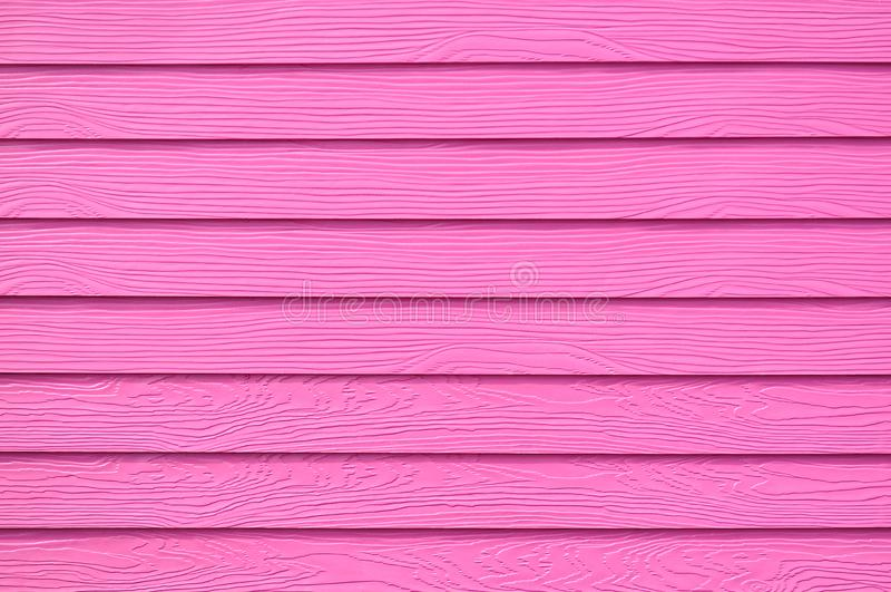 Wall panel paint pink color synthetic wooden plank texture surface background.Outdoor panel engineered wood nature pattern or abst. Ract backdrop vintage royalty free stock photo