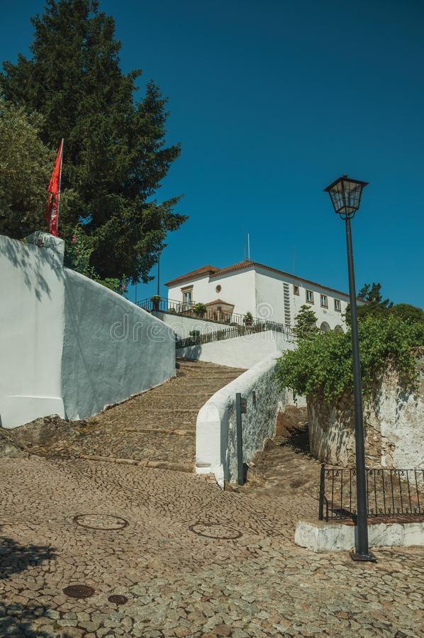 Wall and pathway made of stone with large stairs going uphill stock photos