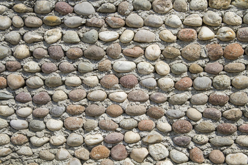 Wall with pebbles stock photography