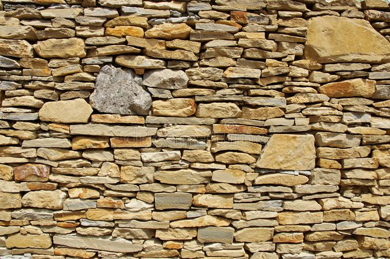 Wall pieces natural rock stone limestone Sandstone texture background light. Rock texture. Exterior element stock images
