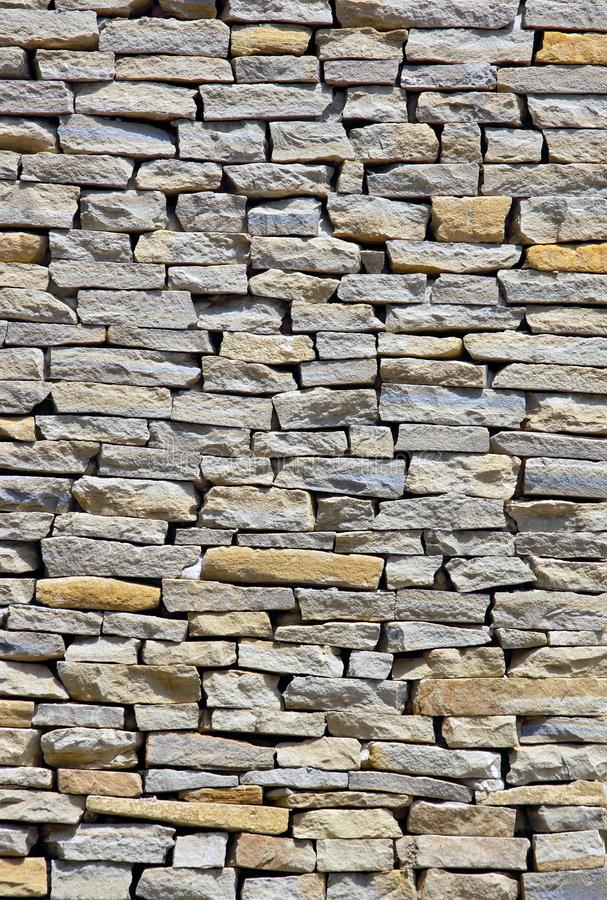 Wall pieces natural rock stone limestone Sandstone texture background light. Rock texture. Exterior element royalty free stock photo