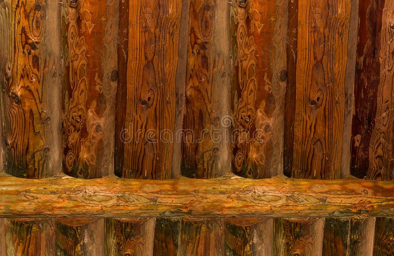 Wall pine log, background fence natural texture with patina stock photos