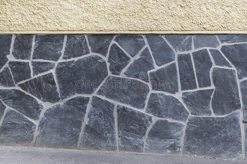 Wall with plastering and stone slates background royalty free stock photography