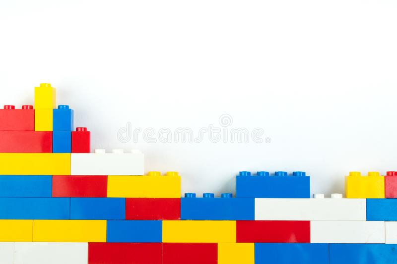 Wall from Plastic building blocks isolated on white background. Top view with copy space. Wall from Plastic building blocks isolated on white background. Top royalty free stock photography
