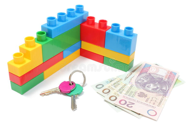 Wall of plastic colorful building blocks with home keys and money. Closeup of home keys, wall of plastic colorful building blocks and banknotes, building blocks stock image