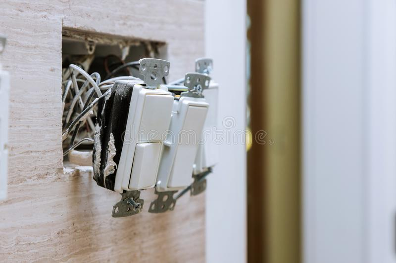 Wall power installation with installing group of electrical switch on bathroom interior stock photo