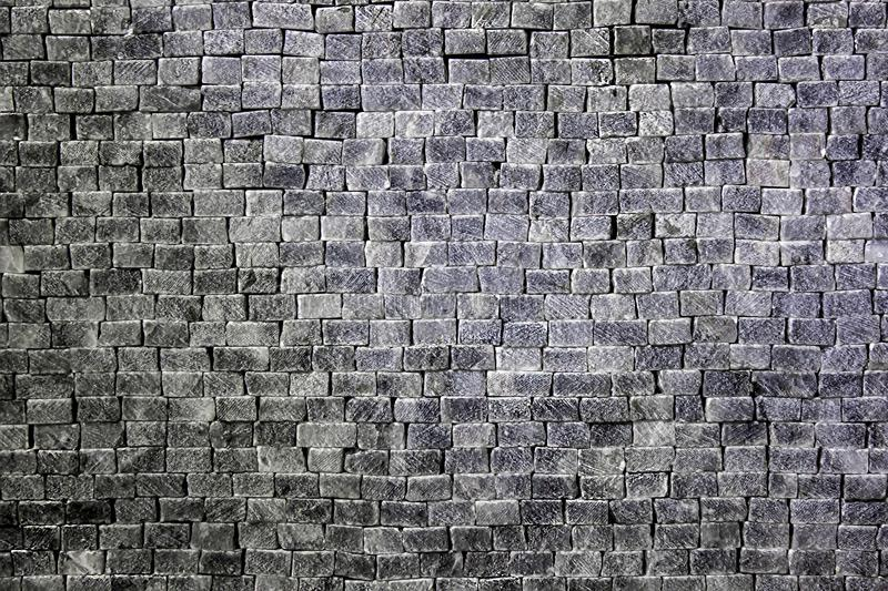 Wall of rectangular gray-white stones and bricks royalty free stock images