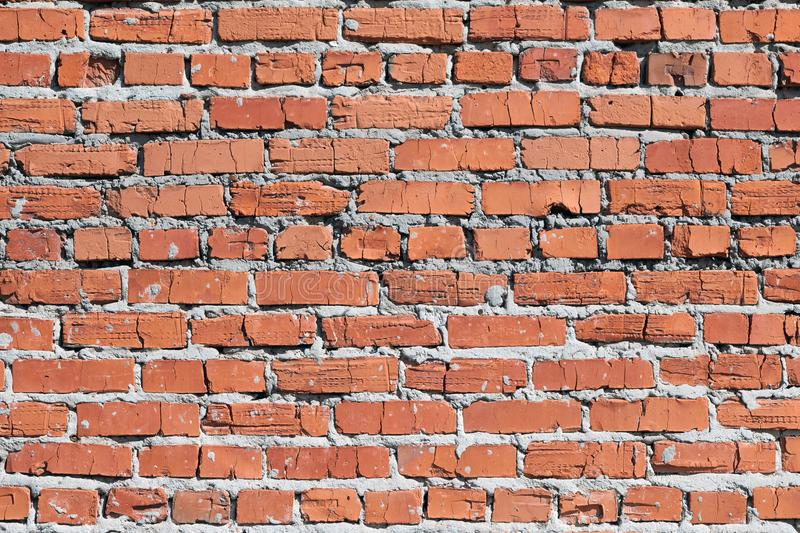 Wall of red brick. Masonry is uneven. royalty free stock image