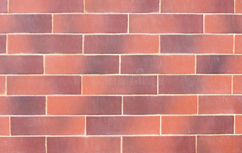 Wall of red decorative bricks. stock photos
