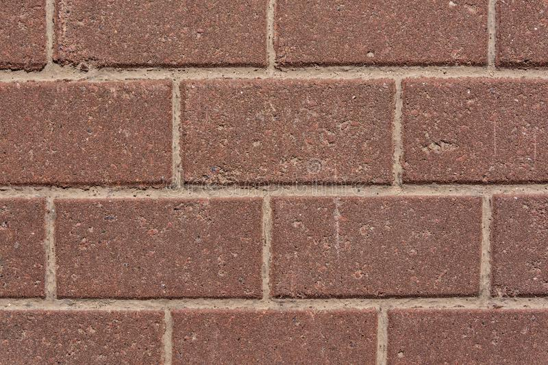 Wall of red granite bricks stock photo
