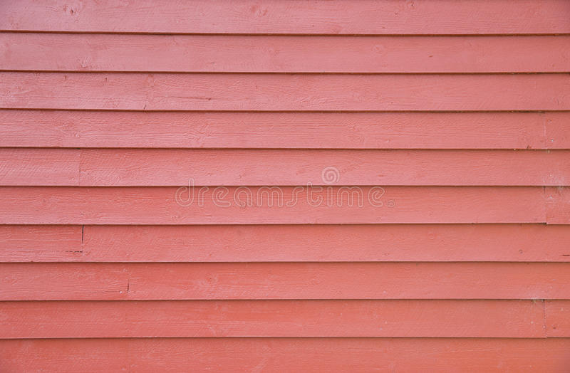 Wall of red wooden house royalty free stock photo