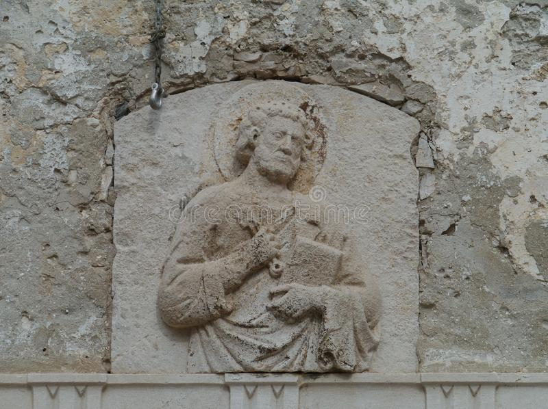 A wall relief in Korcula in Croatia. A sculptural wall relief in the centre of the historic city Korcula on the island Korcula in the Adriatic sea of Croatia royalty free stock photo