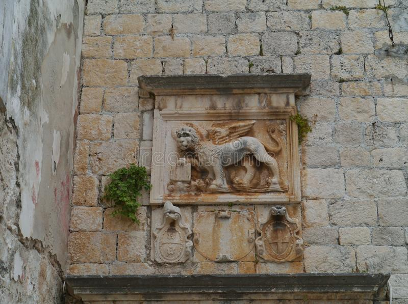 A wall relief in Korcula in Croatia. A sculptural wall relief in the centre of the historic city Korcula on the island Korcula in the Adriatic sea of Croatia royalty free stock photography