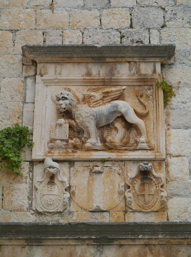 A wall relief in Korcula in Croatia. A sculptural wall relief in the centre of the historic city Korcula on the island Korcula in the Adriatic sea of Croatia royalty free stock images