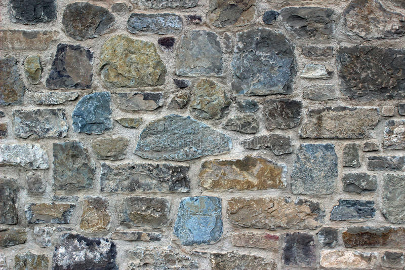 Wall rocks. Detail of a wall of granite rocks of a country house royalty free stock photography