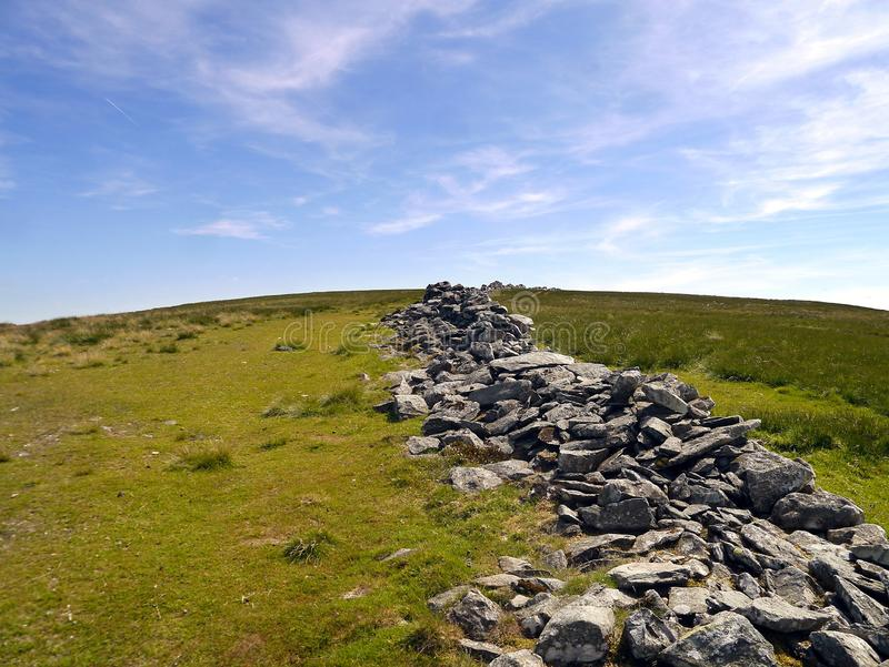 Wall running over hill on High Street, Lake District royalty free stock images