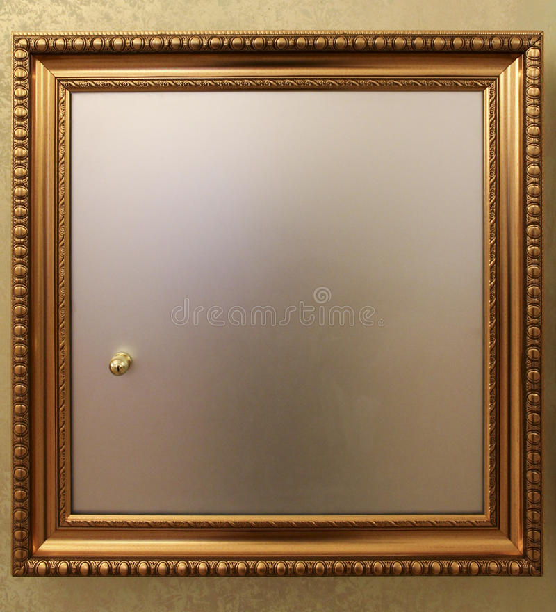 In-wall Safe Door With A Golden Frame Stock Photo