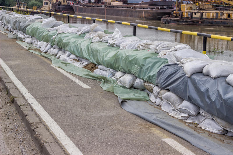 Wall of sandbags for flood defense royalty free stock images