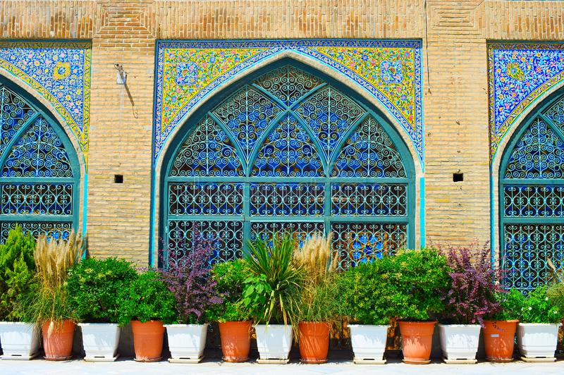 Shah Mosque wall. Tehran, Iran. Wall at the Shah Mosque, also known as the Imam Khomeini Mosque is a mosque in the Grand Bazaar in Tehran, Iran stock image
