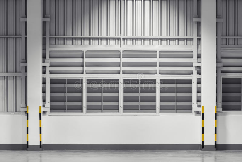 Wall. Siding sheet and louver use for wall of factory, nighttime stock image