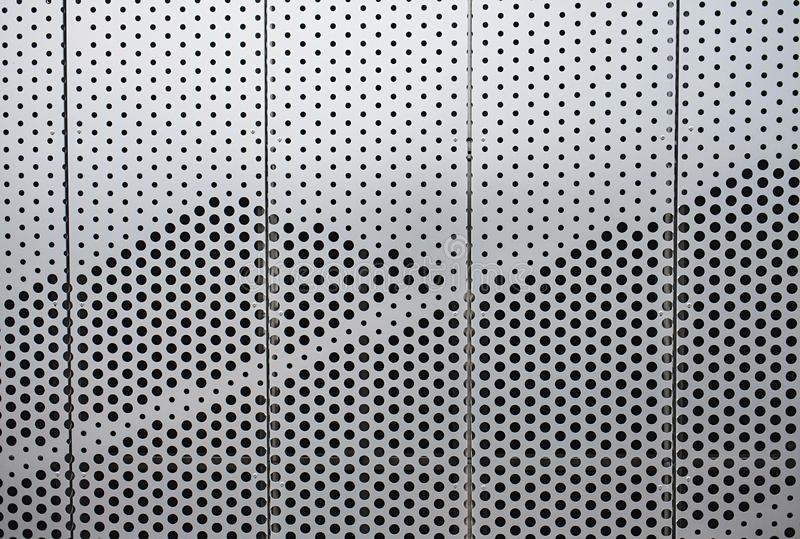 Wall of silver metal futuristic office building stock photo