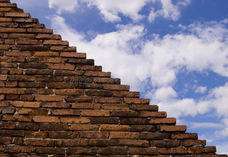 Wall and sky. Abstract background with old brick wall and sky royalty free stock image
