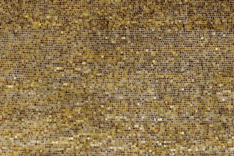 Wall of small gold plates stock image
