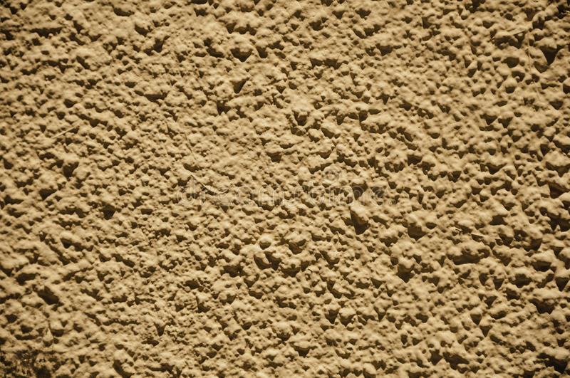 Wall with small gravel inserted into the plaster at Merida. Close-up of wall with small gravel inserted into the plaster making a quaint background at Merida royalty free stock photos
