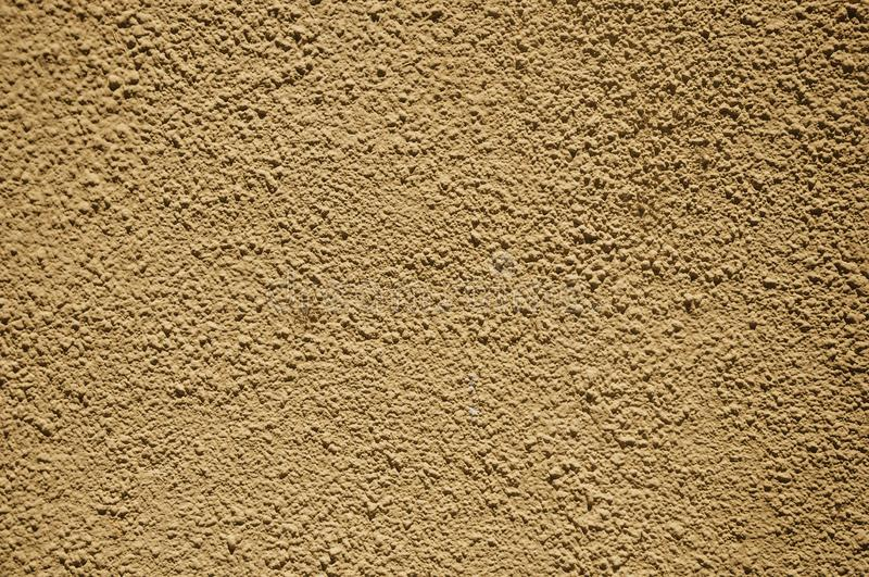 Wall with small gravel inserted into the plaster at Merida. Close-up of wall with small gravel inserted into the plaster making a quaint background at Merida stock photography