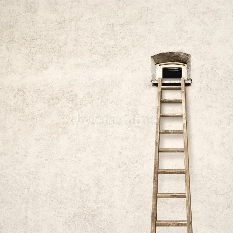 Wall with a small window and wooden ladder royalty free stock photography
