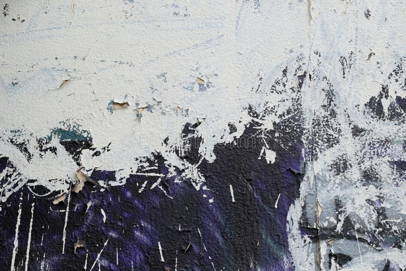 Wall smudged with white paint. Blue wall smudged with white paint. Abstract background stock image